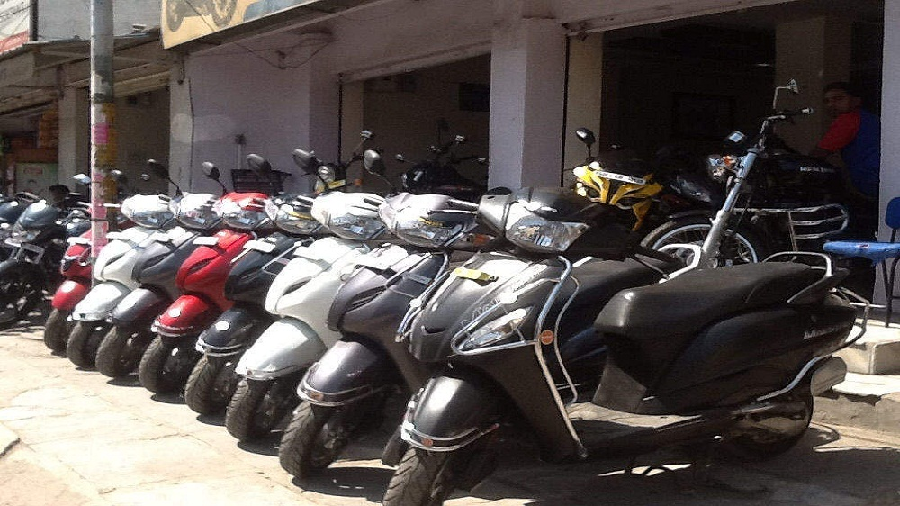 how to invest in two wheeler brands