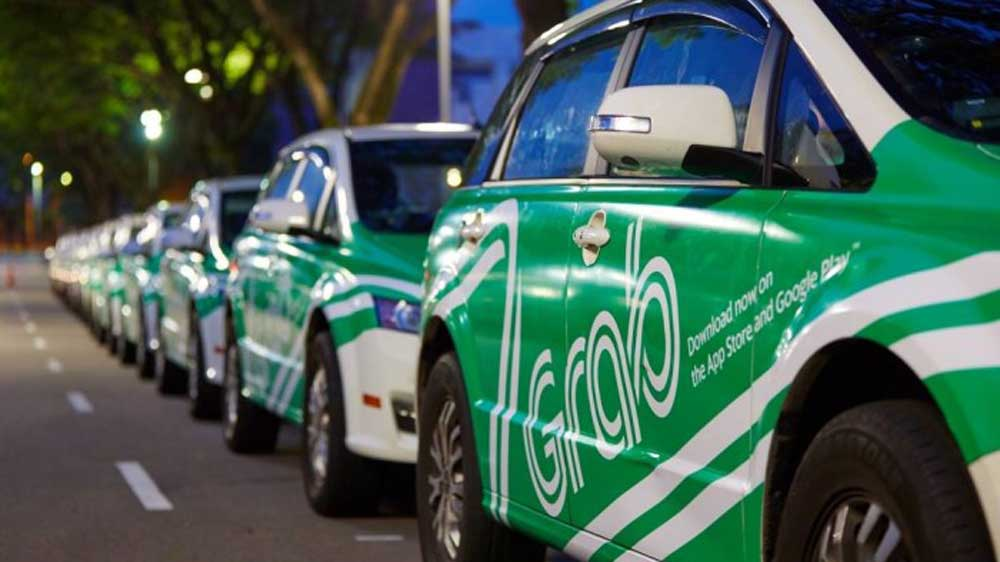 Grab is in talks to invest $100 million in OYO for business expansion